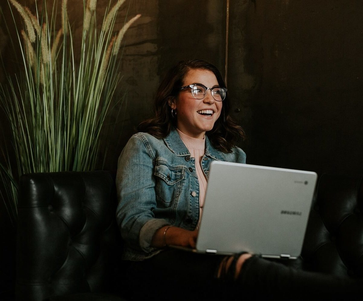 seated woman with laptop